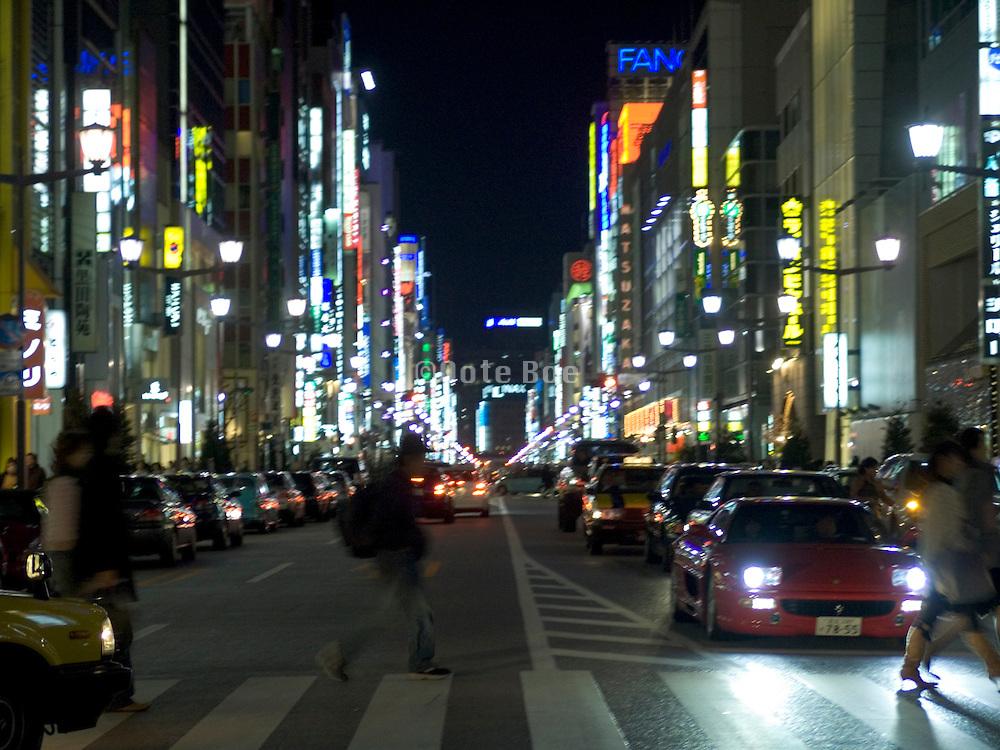 a major crossroad through the city at night Ginza Tokyo