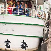 Fishermen relaxing on boat, Bluefin Auction 2010, Dongang Port, Pingtung County, Taiwan