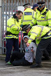 © under license to London News Pictures. 13/02/2011: Police detain a Manchester City fan after the derby match in Manchester when several failed to board their coaches and scuffled with police as they faced off with rival Manchester United fans