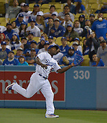 Los Angeles Dodgers right fielder Yasiel Puig #66 makes a catch in the 9th inning. The Los Angeles Dodgers defeated the Cincinnati Reds 3- at Dodger Stadium in Los Angeles , CA.  May 25, 2016. (Photo by John McCoy/Southern California News Group