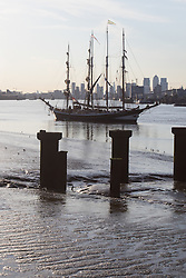 Woolwich, London, September 14th 2016. The afternoon sun illuminates the skyscrapers of Docklands and the Tall ships gathered for the Sail Greenwich Festival 2016 on the River Thames at Woolwich.  &copy;Paul Davey<br /> FOR LICENCING CONTACT: Paul Davey +44 (0) 7966 016 296 paul@pauldaveycreative.co.uk