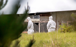 Forensic investigators at the scene of a multiple shooting and house fire which claimed 3 lives and left a man wounded at Mt Tiger, near Whangarei, New Zealand, Thursday, July 27, 2017. Credit:SMPA / Malcolm Pullman **NO ARCHIVING**