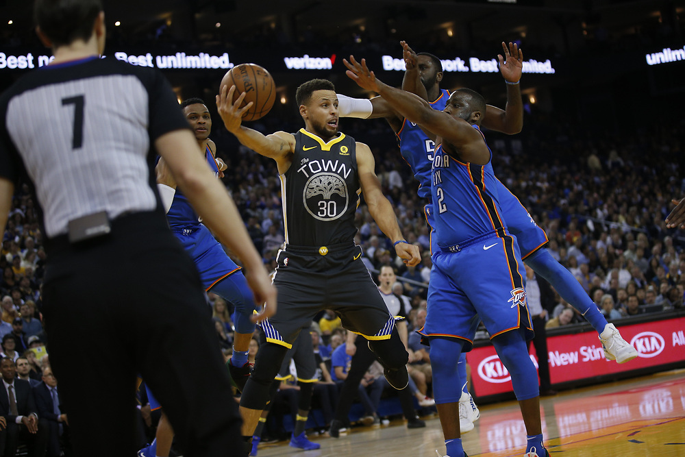 Golden State Warriors guard Stephen Curry (30) looks to pass during the first half of an NBA game between the Warriors and Oklahoma City Thunder at Oracle Arena, Tuesday, Feb. 6, 2018, in Oakland, Calif.