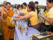05 DECEMBER 2014 - BANGKOK, THAILAND: Thais present monks with offerings during a Buddhist prayer service on Sanam Luang, the parade ground in front of the Grand Palace, for Bhumibol Adulyadej, the King of Thailand. Thais marked the 87th birthday of the King Friday. The revered Monarch was scheduled to make a rare public appearance in the Grand Palace but cancelled at the last minute on the instructions of his doctors. He has been hospitalized in Siriraj Hospital, across the Chao Phraya River from the Palace, since early October.    PHOTO BY JACK KURTZ