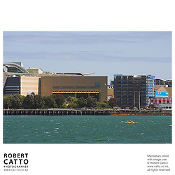 Kayakers skim past the National Museum, Te Papa Tongarewa seen from Lambton Harbour, Wellington, New Zealand.<br />