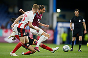 Jay Rodriguez of Burnley is tackled by George Dobson of Sunderland   during the EFL Cup match between Burnley and Sunderland at Turf Moor, Burnley, England on 28 August 2019.