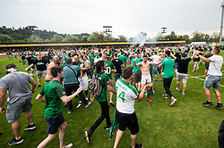 Filip Uremovic of NK Olimpija and supporters of Olimpija celebrate after they became Slovenian National Champion 2018 after the football match between NK Domzale and NK Olimpija Ljubljana in 36th Round of Prva liga Telekom Slovenije 2017/18, on May 27, 2018 in Sports park Domzale, Domzale, Slovenia. Photo by Vid Ponikvar / Sportida