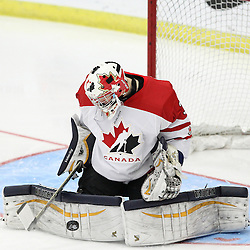 COBOURG, - Dec 19, 2015 -  Gold Metal Game - Russia vs Canada West at the 2015 World Junior A Challenge at the Cobourg Community Centre, ON. Goaltender Matthew Murray #31 of Team Canada West makes the save during the third period.(Photo: Tim Bates / OJHL Images)