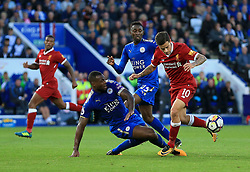 Wes Morgan of Leicester City slides in to win a tackle on Philippe Coutinho of Liverpool - Mandatory by-line: Paul Roberts/JMP - 23/09/2017 - FOOTBALL - King Power Stadium - Leicester, England - Leicester City v Liverpool - Premier League