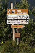 Hotel and hiking route signposts in rural South Tyrol, south-west of Bolzano, northern Italy.