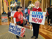 23 JANUARY 2020 - DES MOINES, IOWA: CHERIE MORTICE, left, and BARBARA LANG, both from Des Moines wait for a rally against factory farms to start in the Iowa State Capitol. About 75 people, including farmers, environmental activists, and supporters of family farms, came to a protest in the rotunda of the state capitol in Des Moines. They are trying to pressure Iowa lawmakers to pass a moratorium against new factory farm construction in Iowa.      PHOTO BY JACK KURTZ