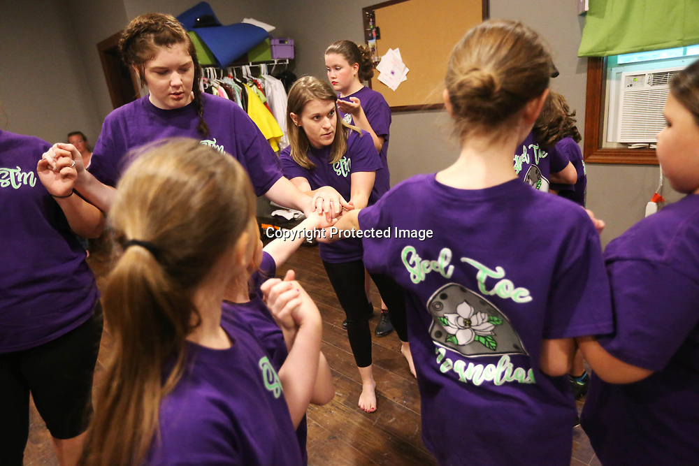 Leah Doyle, center, instructor of the Steel Toe Magnolias clogging group, teaches the girls a new move where they rotate in a circle in the studio at her home in Amory. Doyle teaches a competitive group ages 7-18, a youth class ages 2-6 and an adult class each week.