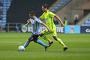 Coventry City midfielder John Fleck gets away from Southend United forward David Mooney during the Sky Bet League 1 match between Coventry City and Southend United at the Ricoh Arena, Coventry, England on 31 August 2015. Photo by Simon Davies.