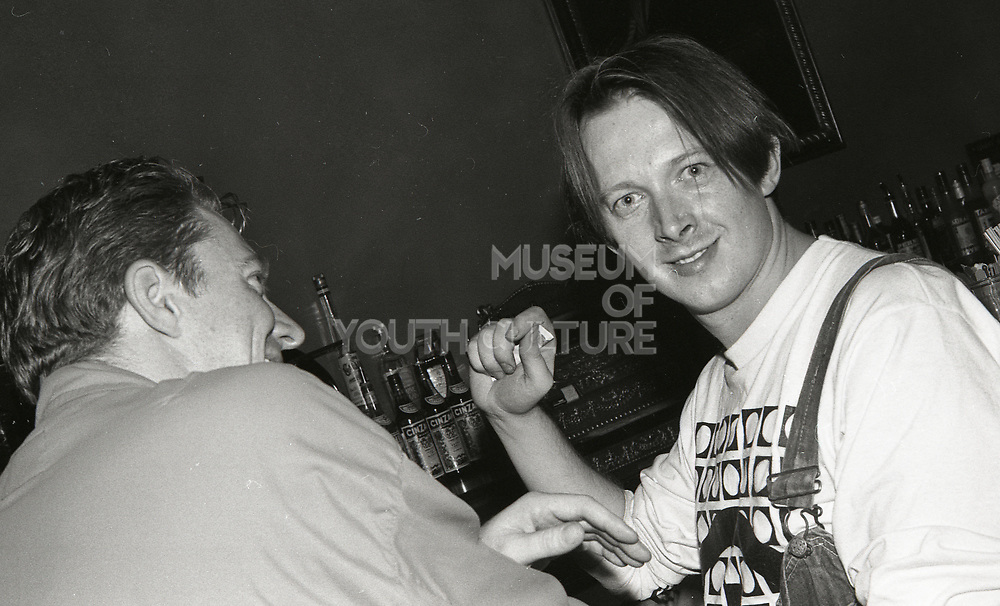 808 state member at the bar, Piccadilly venue, Manchester, 1989.