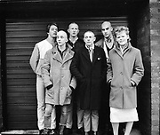 Nev, Paul, Phil, Lee, Tina and others stood in front of garage door, High Wycombe, UK, 1980s