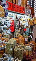 A colorful display of dried goods and preserves at a market stall in Singapore, Asia.