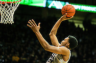 December 7th, 2013:  Colorado Buffaloes redshirt senior guard Beau Gamble (14) elevates for a lay up in the first half of the NCAA Basketball game between the Kansas Jayhawks and the University of Colorado Buffaloes at the Coors Events Center in Boulder, Colorado