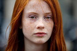 © Licensed to London News Pictures. 04/09/2016. Breda, The Netherlands. Anyaka Erkelens attends The Redhead Days festival as thousands of redheads fill a Dutch city Breda to celebrate International Redhead Day event in The Netherlands on Sunday, 4 September 2016. Every year natural redheads from more than 80 countries come together at 'Roodharigendag' annual weekend long festival to celebrate their ginger genes. The event also holds the world record for the largest number of natural redheads being in one place. Photo credit: Tolga Akmen/LNP