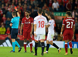 LIVERPOOL, ENGLAND - Wednesday, September 13, 2017: Liverpool's Joe Gomez looks dejected as referee Danny Makkelie shows him a red card for a second yellow and sends him off during the UEFA Champions League Group E match between Liverpool and Sevilla at Anfield. (Pic by David Rawcliffe/Propaganda)