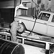A Studebaker worker applies undercoating to a 1960 Studebaker Lark at the company's South Bend, Indiana plant.