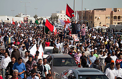 © under license to London News Pictures.  18/02/2011. People march to the cemetary to bury Ali Al Almoumem, the third person to be buried today in Sitra after he was killed on Wednesday at the Pearl Roundabout. Photo credit should read Michael Graae/London News Pictures