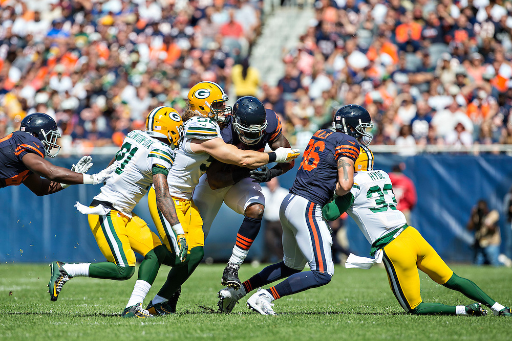 CHICAGO, IL - SEPTEMBER 13:  Martellus Bennett #83 of the Chicago Bears runs the ball and is hit by Clay Matthews #52 of the Green Bay Packers at Soldier Field on September 13, 2015 in Chicago, Illinois.  The Packers defeated the Bears 31-23.  (Photo by Wesley Hitt/Getty Images) *** Local Caption *** Martellus Bennett; Clay Matthews
