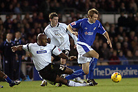 Photo: Kevin Poolman.<br />Derby County v Leicester City. Coca Cola Championship. 25/11/2006. Gareth Mcauley of Leicester is tackled by Darren Moore of Derby.