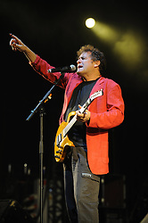 """File photo - Johnny Clegg performs live on stage during the Paleo Festival in Nyon, Switzerland on July 22, 2010. Clegg, has died at the age of 66, after a long battle with pancreatic cancer. Known as the """"white Zulu"""", he was a vocal critic of the apartheid government which ruled until 1994.<br /> The British-born musician, who uniquely blended western and Zulu music, was diagnosed with cancer in 2015. Photo by Loona/ABACAPRESS.COM"""