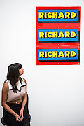 A retrospective of Pop-art pioneer Richard Hamilton opens at the Tate this week. He was widely regarded as the founding figure of Pop art, and this exhibition presents over 60 years of work from 1950s installations to his final paintings of 2011. Major works include: Fun House – An immersive Pop installation featuring a jukebox and blown-up images from Hollywood movies, science-fiction and advertising;  Swingeing London – An iconic image of Mick Jagger following his arrest on drugs charges in 1967; Sign  (pictured); and his final work – A triptych of computer-aided images printed onto canvas, inspired by the Italian Renaissance masters. Tate Modern, London, UK 11 Feb 2014.