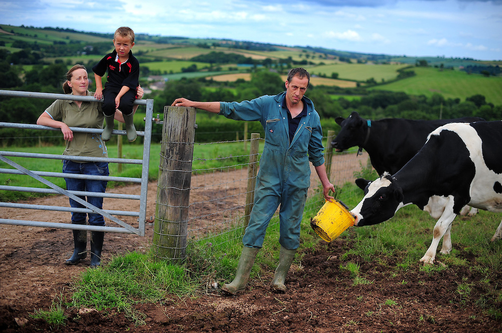 Picture By Jim Wileman  20/07/2009  Dairy Farmer Will Jones and his wife Jo, and son Nick, pictured at Higher Living Farm, Devon.