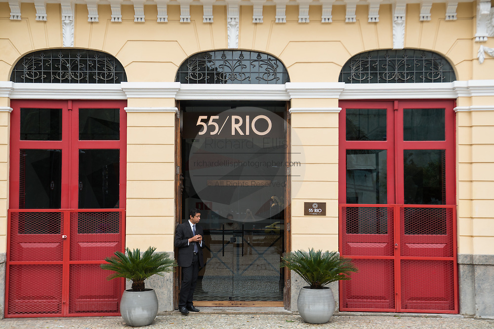 The doorman waits at the Hotel 55 Rio in an restored Portuguese colonial building along the Avenida República do Paraguai in the Lapa neighborhood of Rio de Janeiro, Brazil.