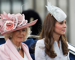 LONDON- UK - 14-JUNE-2014: The annual Trooping the Colour Ceremony for Queen Elizabeth;s Birthday is held in London. Members of the royal family travel by carriage from Buckingham Palace to Horseguards Parade for the Trooping Ceremony.<br /> HRH The Duches of Cambridge with the Duchess of Cornwall<br /> Photograph by Ian Jones