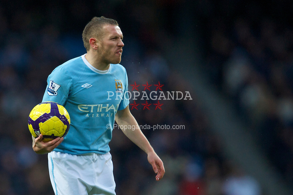 MANCHESTER, ENGLAND - Sunday, February 21, 2010: Manchester City's Craig Bellamy argues with the referee during the Premiership match against Liverpool at the City of Manchester Stadium. (Photo by: David Rawcliffe/Propaganda)