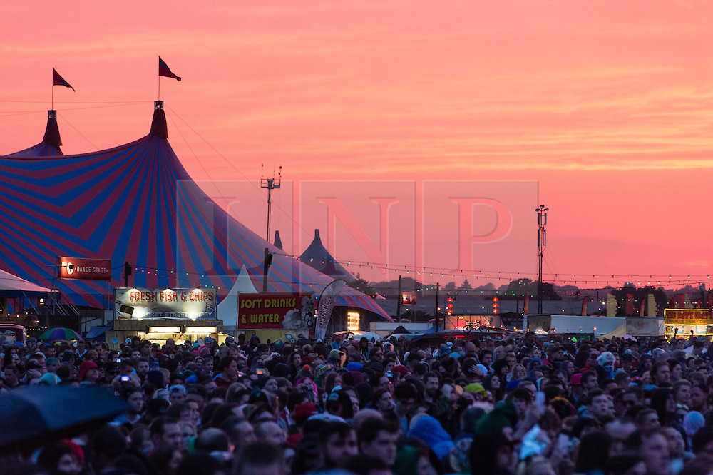 © Licensed to London News Pictures. 29/08/2015. Reading Festival, UK. A red sunset over Reading Festival 2015 Day 2.  Photo credit: Richard Isaac/LNP