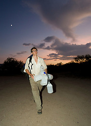 Richard Alun-Davis returns after a gruelling 11 hour patrol of the desert in 42 degree heat. Alun-Davis is carrying water bottles that the volunteers had left in the desert and were emptied by migrants moving through the area just north of the Mexico border.