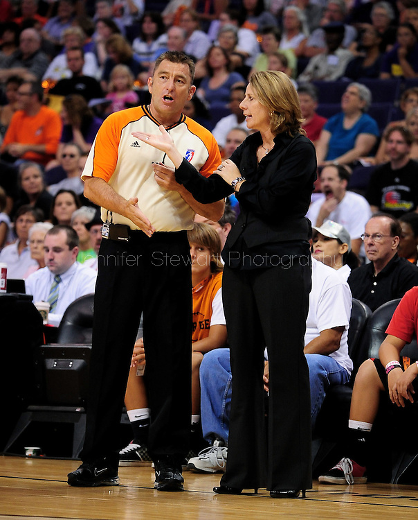 Sep 25, 2011; Phoenix, AZ, USA; Minnesota Lynx head coach Cheryl Reeve (right) talks with a WNBA official on the court while playing Phoenix Mercury at the US Airways Center. The Lynx defeated the Mercury 103-86. Mandatory Credit: Jennifer Stewart-US PRESSWIRE