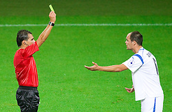 Referee Roberto Ponis with yellow card for Aris Zarifovic of Gorica during the football match between NK Olimpija and HIT Gorica, played in the 11th Round of Prva liga football league 2010 - 2011, on September 25, 2010, SRC Stozice, Ljubljana, Slovenia. (Photo by Vid Ponikvar / Sportida)