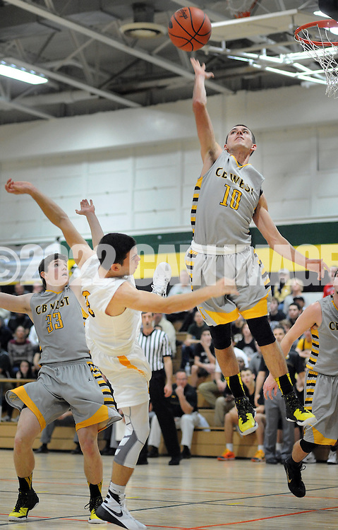 Archbishop Wood's Tommy Funk (3) falls backwards after attempting a layup as Central Bucks West's Luke Irons (10) blocks the shot in the first quarter Saturday December 12, 2015 at Archbishop Wood in Warminster, Pennsylvania. (Photo by William Thomas Cain)