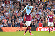 Aston Villa striker Gabriel Agbonlahor (11) scores a goal and celebrates holding a t shirt in support of carl ikeme during the EFL Sky Bet Championship match between Aston Villa and Hull City at Villa Park, Birmingham, England on 5 August 2017. Photo by Dennis Goodwin.