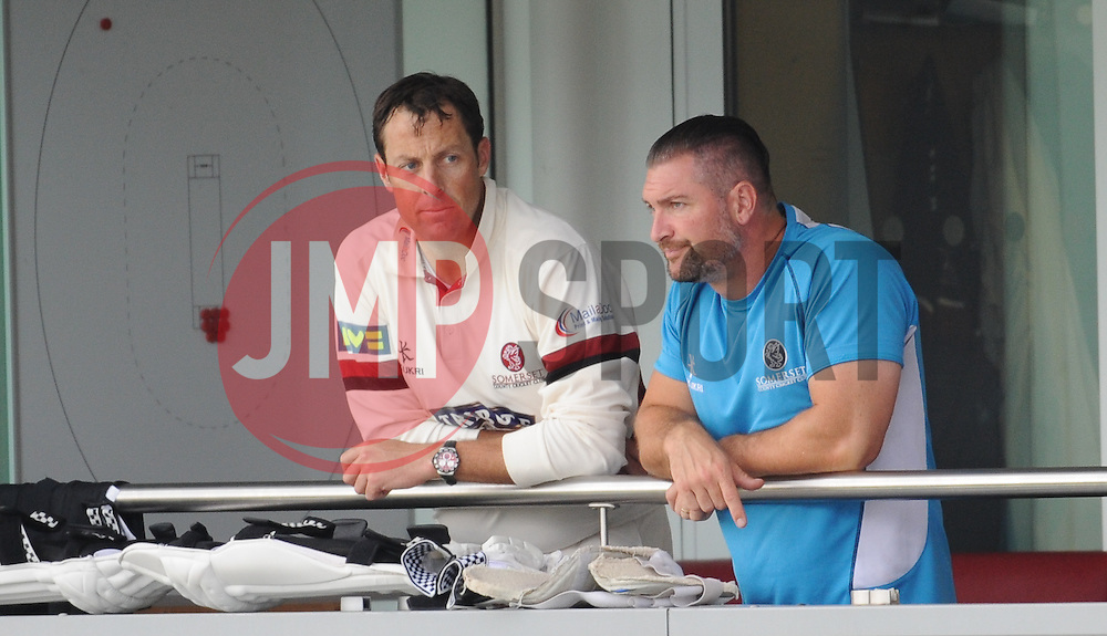 Somerset captain Marcus Trescothick watches the rain with Somerset strength and conditioning coach Darren Veness - Mandatory byline: Alex Davidson/JMP - 07966386802 - 22/08/2015 - Cricket - County Ground -Taunton,England - Somerset CCC v Worcestershire CCC - LV= County Championship Division One - Day 3