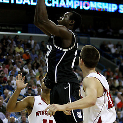 Mar 24, 2011; New Orleans, LA; Butler Bulldogs forward Khyle Marshall (23) shoots over Wisconsin Badgers guard Jordan Taylor (11) and guard Josh Gasser (21) during the first half of the semifinals of the southeast regional of the 2011 NCAA men's basketball tournament at New Orleans Arena.  Mandatory Credit: Derick E. Hingle
