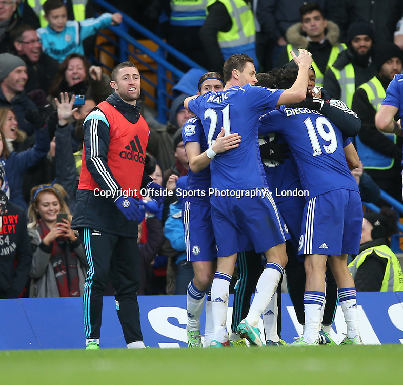 10 January 2015 Premier League Football - Chelsea v Nerwcastle United ;  Chelsea substitute Gary Cahill joins in with the goal celebrations.<br /> Photo: Mark Leech