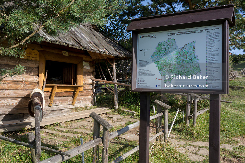 A traditional Polish mountain shepherd's hut selling cheeses to visitors, on 21st September 2019, in Jaworki, near Szczawnica, Malopolska, Poland. Log cabins houses such as these often sell Oszczypek, a smoked cheese made of salted sheep milk exclusively in the Tatra Mountains region of Poland.