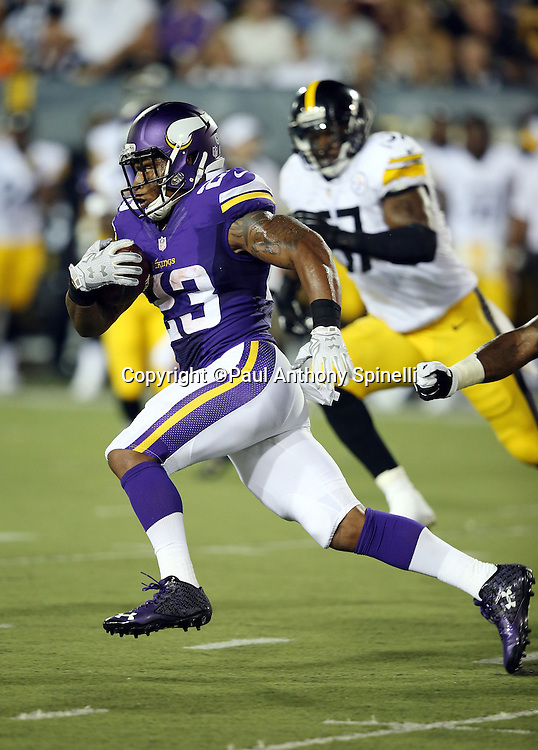 Minnesota Vikings running back Joe Banyard (23) runs the ball in the third quarter during the 2015 NFL Pro Football Hall of Fame preseason football game against the Pittsburgh Steelers on Sunday, Aug. 9, 2015 in Canton, Ohio. The Vikings won the game 14-3. (©Paul Anthony Spinelli)