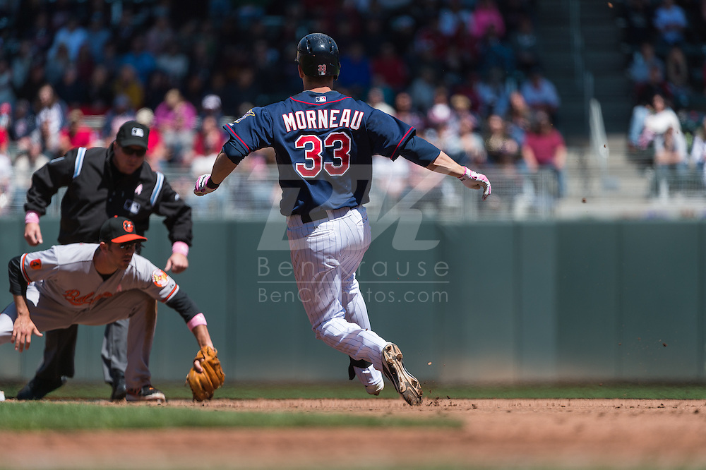 Justin Morneau #33 of the Minnesota Twins slides into 2nd base before being tagged out by J.J. Hardy #2 of the Baltimore Orioles on May 12, 2013 at Target Field in Minneapolis, Minnesota.  The Orioles defeated the Twins 6 to 0.  Photo: Ben Krause