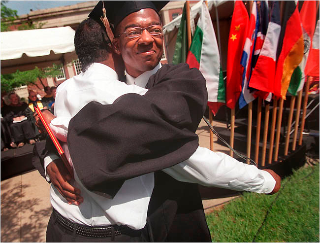 Addison Yadell Young II, Business Administration graduate, of Urbandale, IA, gets a hug from his father after receiving his diploma during the graduation ceremony at Coe College Sunday, May 9, 2004 in Cedar Rapids.