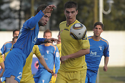 Ivan Brecevic of Gorica and Jovan Vidovic of Domzale at football match of 30th Round of 1st Slovenian League between NK Hit Gorica and Domzale, on April 10, 2010, in Sportni park, Nova Gorica, Slovenia. (Photo by Foto Forma/ Sportida)