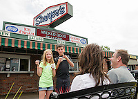 Jill, Adam, Brenda and Larry Rubin cool off with an ice cream at Sawyers Dairy Bar on Thursday afternoon.  (Karen Bobotas/for the Laconia Daily Sun)