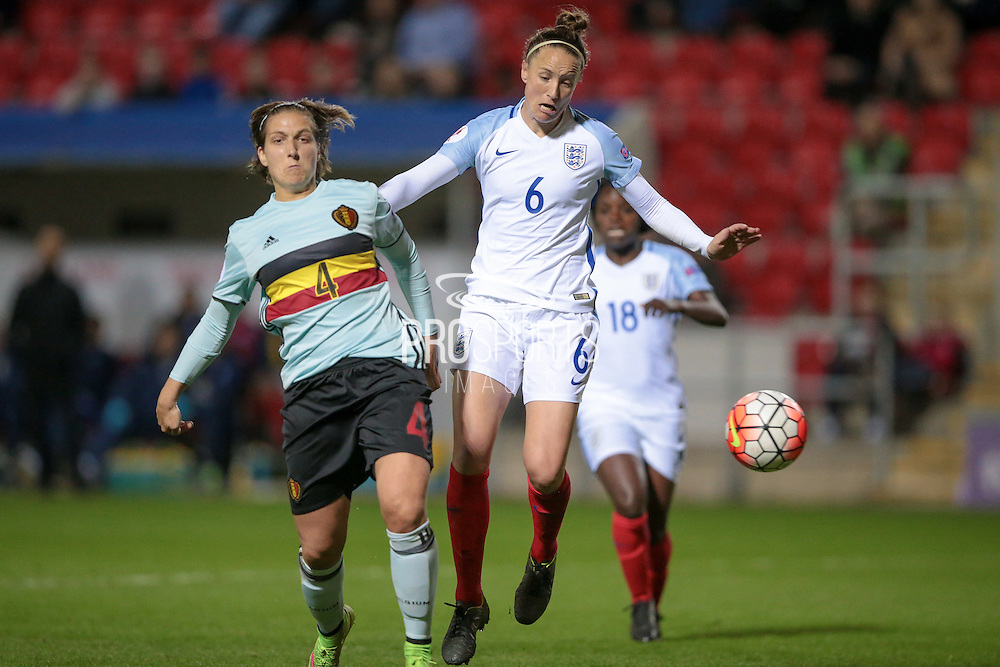 Casey Stoney (England) wins the ball from Maud Coutereels (Belgium) during the Euro 2017 qualifier between England Ladies and Belgium Ladies at the New York Stadium, Rotherham, England on 8 April 2016. Photo by Mark P Doherty.