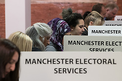 © Licensed to London News Pictures . 08/06/2017 . Manchester , UK . Counting underway at the Manchester Central Convention Centre as the count for the constituencies of Blackley and Broughton, Manchester Central, Manchester Gorton, Manchester Withington and Wythenshawe and Sale East, in the General Election, gets underway at the Manchester Central Convention Centre . Photo credit : Joel Goodman/LNP